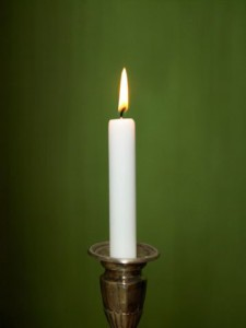 Candle with green background